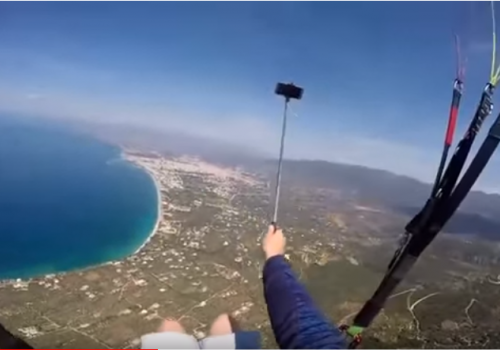 Paraglider Drops Phone from 2,500 Feet Above the Ground