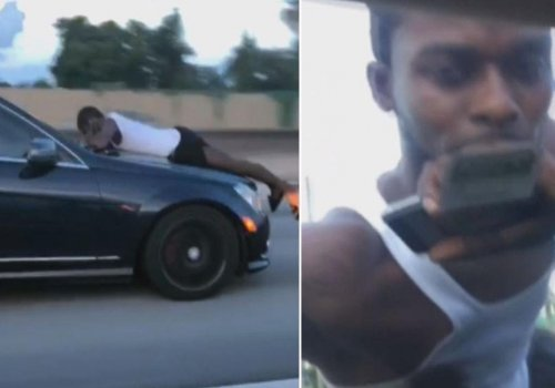 Man Clings to Hood of Car As It Speeds Down Highway