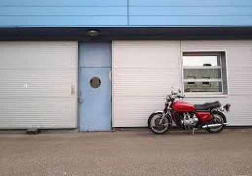 Woman gets trapped in garage as motorcyclist drives off!