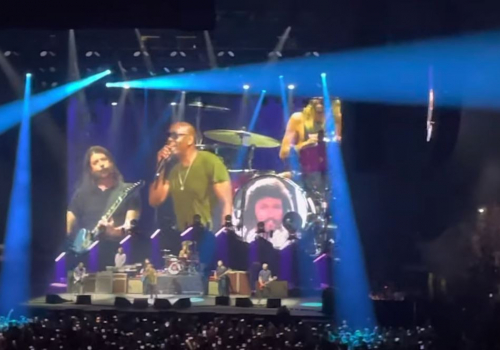 Dave Chappelle Performs on Stage with Foo Fighters at First Full Capacity Show Since Covid
